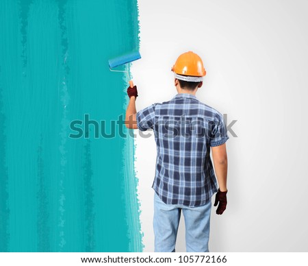 Men painting and paint brush house