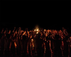 Men performing Balinese dance Kecak (Ramayana Monkey Chant) in a night. Indonesia