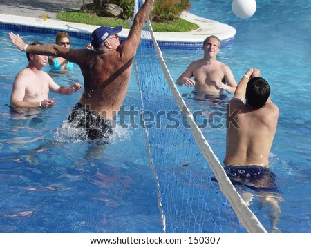 men playing water polo in a swimming pool