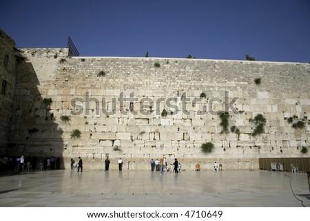 men praying next to the wailing wall, jerusalem,israel - stock photo