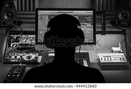 Men produce electronic music in project home studio. \ Silhouette. Black and white image.