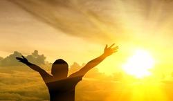 Men raise their arms up the sky. He thanks God