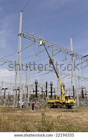 men repairing high voltage power lines
