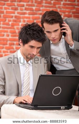 Men resolving a problem on computer