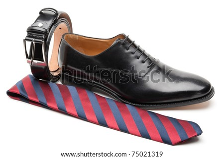 men's accessories: black belt, shoe and red tie