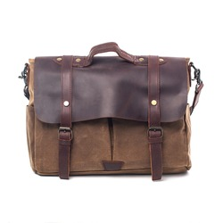 Men's accessories . Brown leather and canvas bags on white background