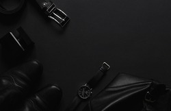 Men's accessories  on the black table with top view with copy space. Fashion backgroun for men, luxury concept. Minimal black trendy 2020.
