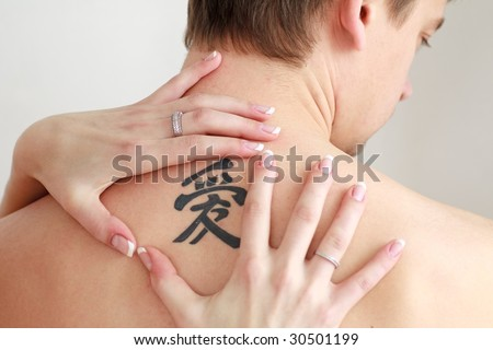 stock photo : Men's back with a big tattoo
