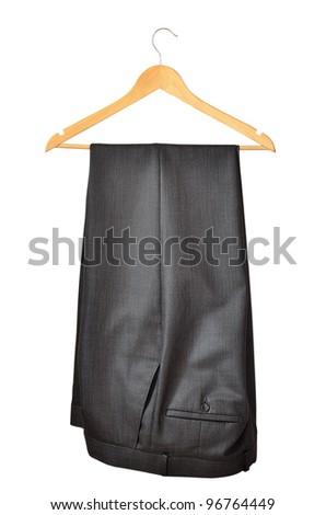 Men's black pants on a hanger isolated on white background