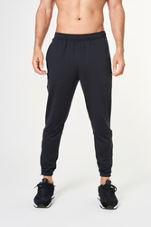 Men's black sweatpants with running shoes