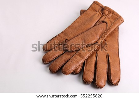Men's brown leather gloves.  On a white background