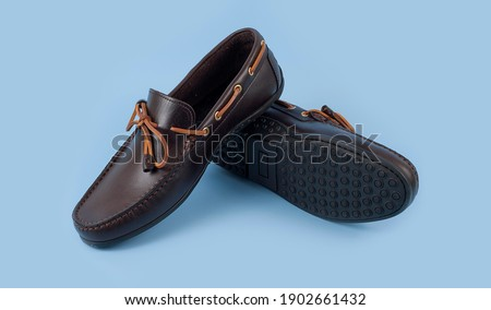 Men's brown moccasins, loafers isolated on blue background. Stock fotó ©