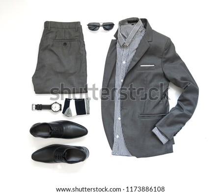Men's casual outfits for man clothing set with gray suit , watch, sock, sunglasses, shirt and black shoe isolate on white background, Top view