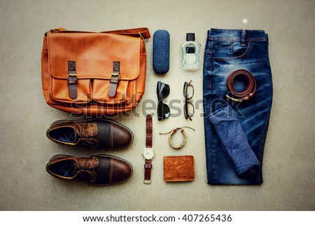 Men\'s casual outfits with accessories on gray grunge background