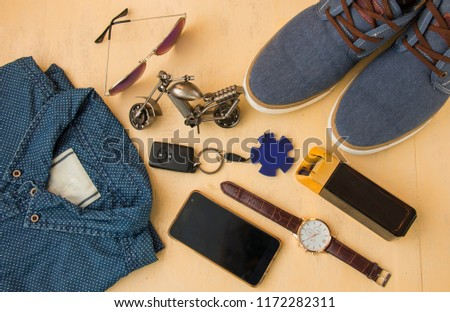 Men's casual outfits with jeans clothes and accessories on a wooden light background, the concept of fashion and beauty, top view #1172282311