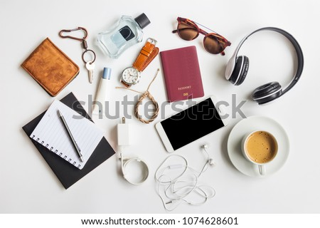 Men's casual outfits with travel items accessories on white background, lifestyle holiday traveler concept, flat lay fashion and beauty