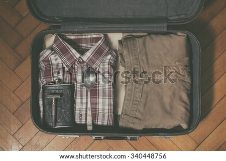 men's clothing in old suitcase...