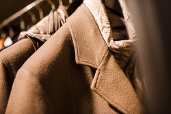 Men's clothing store. Men's outerwear on a hanger in a store, smart look, close-up