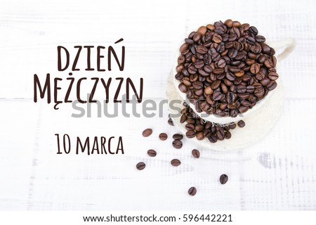 Men's day card with Polish words  Dzie? M??czyzn (Men's day) and coffee beans cup on white wooden background Zdjęcia stock ©