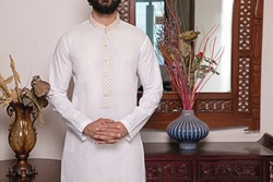 Men's fabric kurta, shalwar kameez, cotton, boski, karandi latest embroidered style with beautiful modeling and photography.