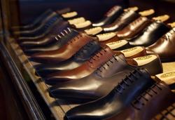 Men's fashion leather shoes on shop window. Concept of diversity, high quality, elegance, honest business relationship