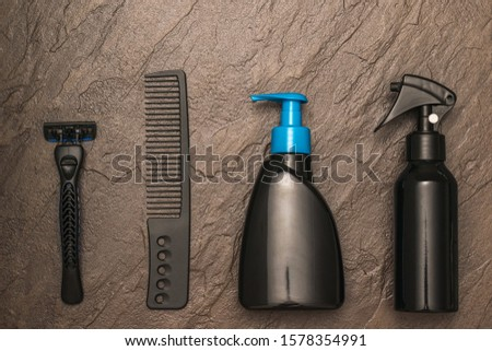 Men's hair and beard care set on stone background. Set for care of a man's face. Flat lay. #1578354991