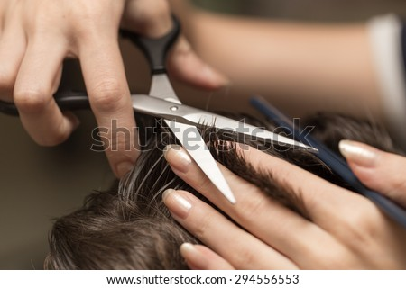 men\'s hair cutting scissors in a beauty salon