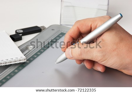 Men's hand drawing on the tablet pc