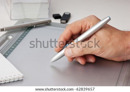 Men's hand draws tablet pc