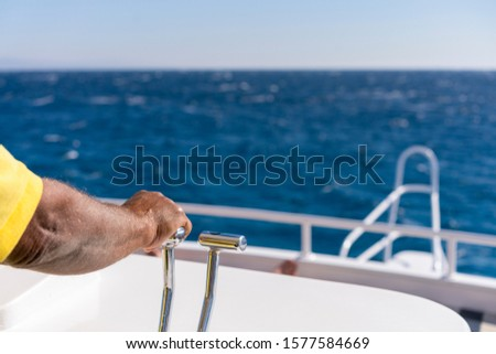 Men's hand drives a yacht. concept of sea recreation and tourism