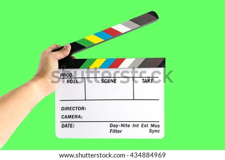 Men's hand holding camera slate  for the filming isolated on green background. #434884969