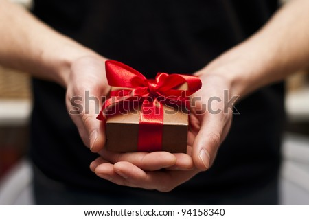 Men's hand holding gift box