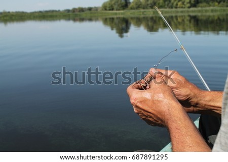 Men's hands fill the crab for fishing #687891295
