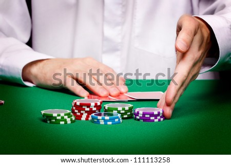 men's hands, playing cards and chips. Poker game