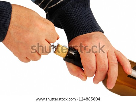 men's hands pull corkscrew cork from the bottle. Isolated white background.