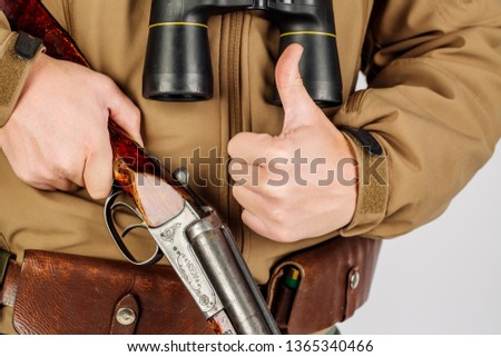 Men's hands with a hunting gun reload the cartridge #1365340466