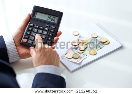 Men's hands with calculator. Calculation at office