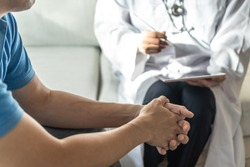 Men's health disease, on prostate cancer or mental illness concept with male patient having consultation with doctor or psychiatrist working on diagnostic examination in medical clinic or hospital