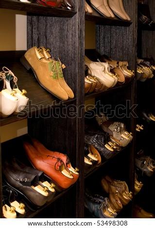 Men`s italian designer leather shoes on a menswear store. #53498308