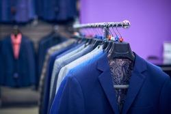 Men's jackets on hangers in the men's store