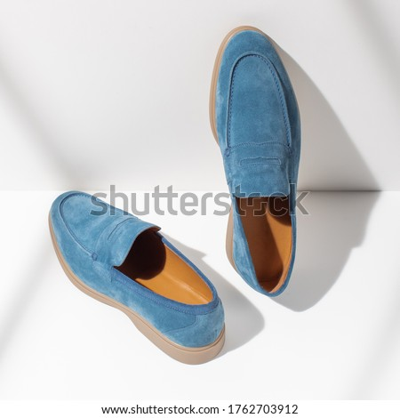 Men's leather blue loafers on a white background. Stylish men's shoes Stock fotó ©