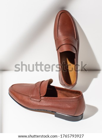 Men's leather brown loafers on a white background. Stylish men's shoes Stock fotó ©