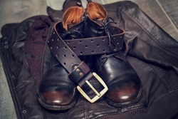 Men's leather jacket, high boots and a leather belt with buckle