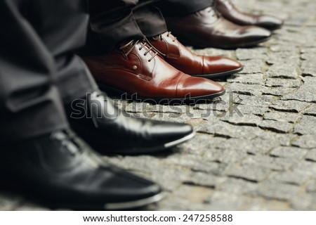Men\'s legs in shoes on the street
