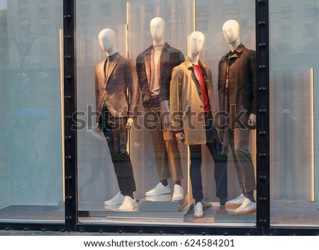 Men's mannequins in the window of a luxury store