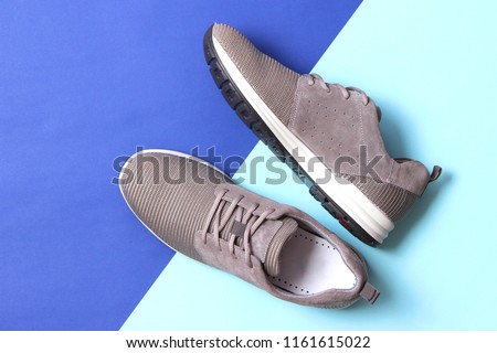 men's sneakers on a colored background top view. men's footwear. minimalism