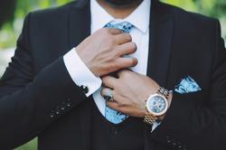 Men's watch, close-up golden hand watch. Best accessories for man.