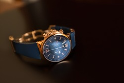 Men's watch, close-up golden hand watch. Best accessories for man