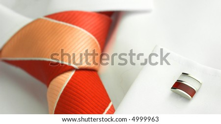 Men's white shirt with striped tie and cufflink