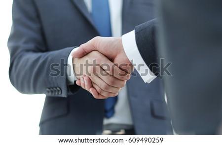 men shaking hands. confident...